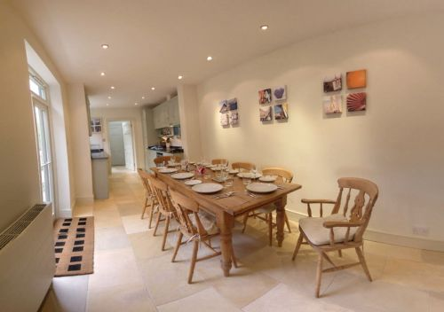 The light and airy Breakfast Room has plenty of room for eight to sit down together.