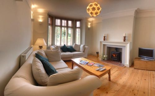The spacious Living Room features a woodburning stove.