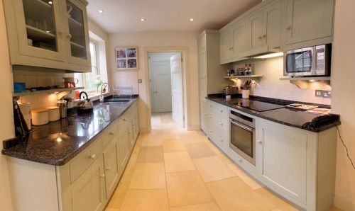 The Kitchen is well equipped with recessed lighting and underfloor heating.