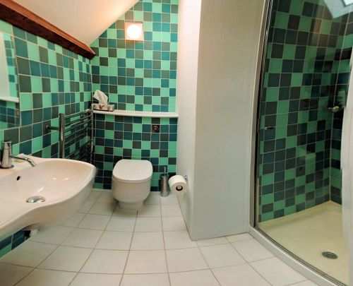 There is a smart ensuite shower room serving the double bedroom on the second floor