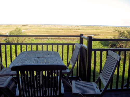 The view from the Master Bedroom and balcony across the marshes, dunes, beach and sea.