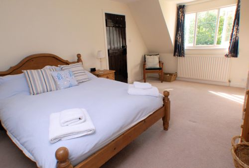 The spacious Master Bedroom overlooking the garden