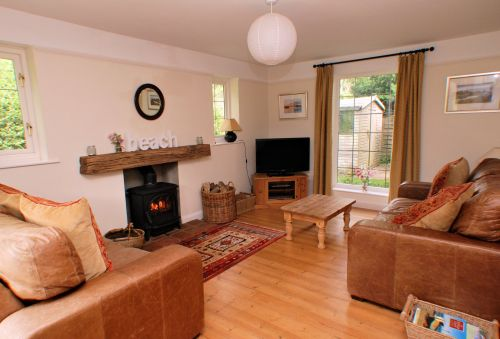The comfortable Lounge features a multi-fuel stove and French windows to the garden