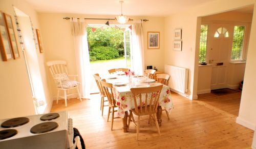 The light and airy Kitchen/Diner has French windows to the garden