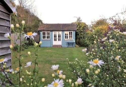rear garden and summerhouse.