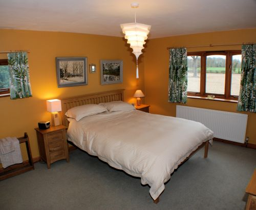 The large and comfortable Guest Bedroom overlooks farmland. Guests are welcome to enjoy the garden.
