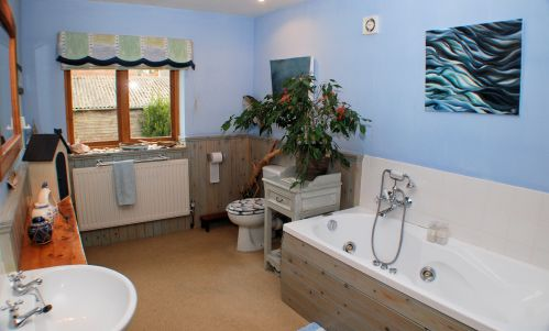 The spacious Guest Bathroom is adjacent to the Guest Bedroom, with use of bathrobes included. Relax in the Jacuzzi bath.