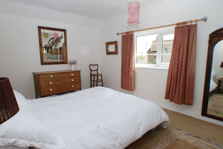 Double Bedroom with views to the village green and the sea