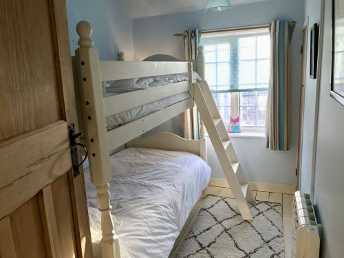 The second bedroom with full-size bunk beds.