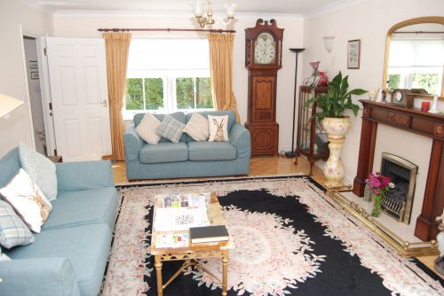 Guests are welcome to relax in the spacious Guest Lounge. Door leads off from here in to the Garden. Guests may enjoy the garden if they wish, outdoor furniture is provide.