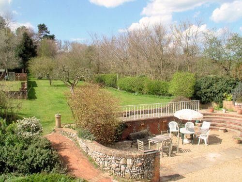 The garden is large with a mixture of lawns, shrubs, sitting areas and outbuildings. This view is taken from the roof terrace on the first floor.