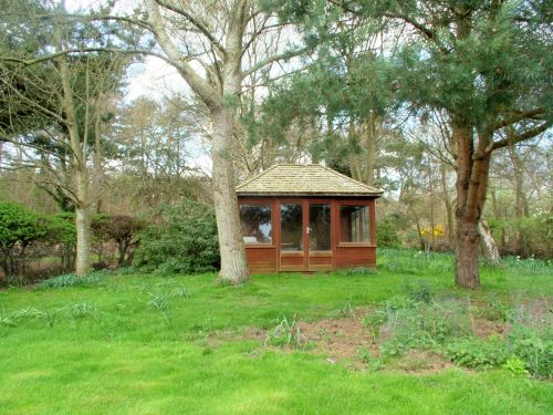 At the top of the garden is a summerhouse. The garden is visited by a variety of wildlife including deer and rabbits whilst robins, coal tits, finches and even woodpeckers regularly come to the birdtable.