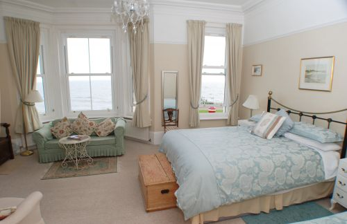 The huge Deluxe Room on the first floor has terrific sea views from the bay window.