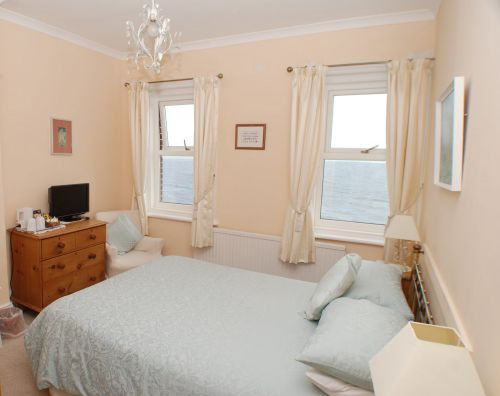 The second floor Double Bedroom is compact but is beautifully furnished and has gorgeous views over the beach and sea.
