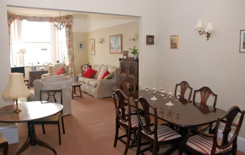 The spacious lounge and dining rooms at Amber House are well equipped.