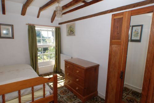 The middle bedroom has views across the garden