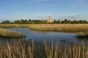 Blythburgh Holy Trinity Church (The Cathedral of the Marshes) across the River Blyth reedbeds